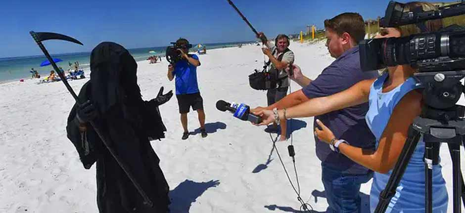 Grim Reaper stalks beach to protest reopening amid pandemic